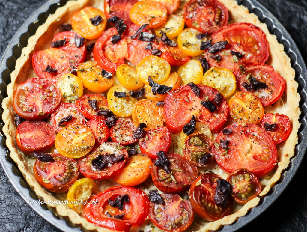 Onions and Parmesan as well as Olives are added for this delicious, gluten-free Tomato Tart